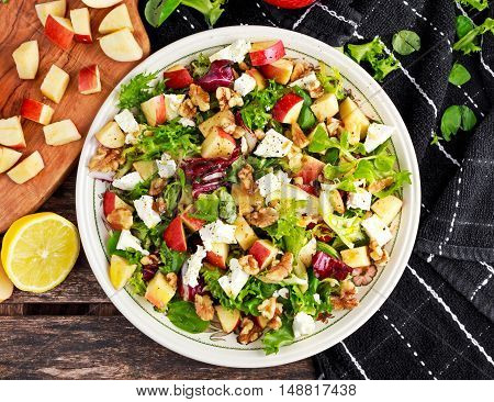 Light Fresh Home made fruit apple salad with walnuts, vegetables, feta cheese.