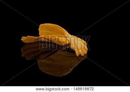 Potato Chip On Black Surface