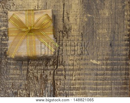 Decorative gift box on the wooden background