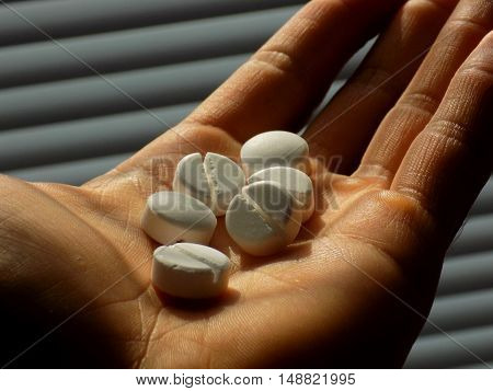 Pills on men hand in psychiatry in hospital