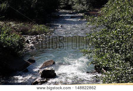 mountain river, strong current, water splash, bubbling, fresh water