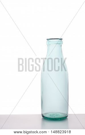 Rustic empty milk glass bottle isolated on white background