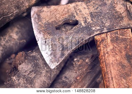 Rustic axe on pile of firewood. Copy space