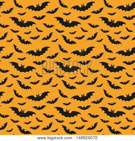 Halloween pattern with bats on the orange background.