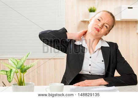 Business Woman Frustrated Her Sick Neck, Portrait In An Office