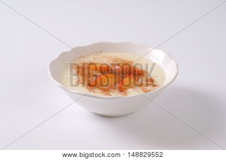 bowl of semolina pudding with apples and cinnamon