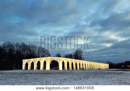 Architecture view of illuminated arcade of ancient trades at Yaroslav's Courtyard in Veliky Novgorod Russia - architecture night landscape of Veliky Novgorod Russia