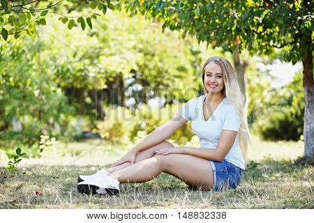 beautiful athletic woman relaxing in the park