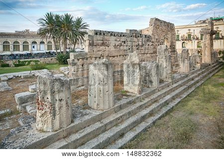 Side view of the ruins of the ancient greek doric temple of Apollo in Siracusa
