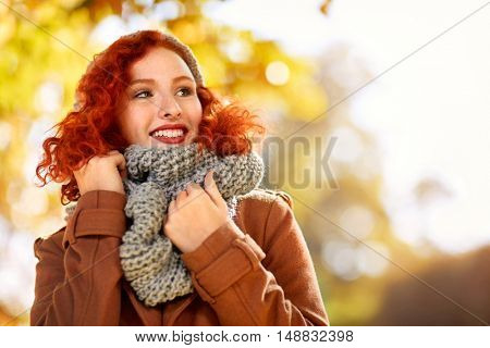 Pretty female red hair in autumn outdoor