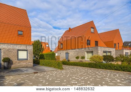 Modern Houses With Striking Red Slate Roof Tiles