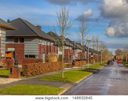 Family Houses With Gardens In A Suburban Street