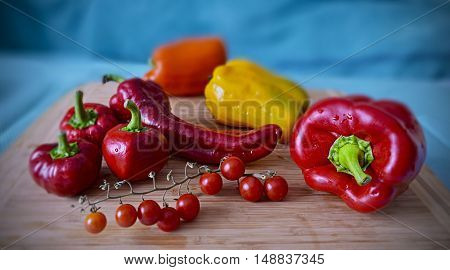 fresh ripe red yellow orange peppers and cherry tomatoes, home grown autumn harvest