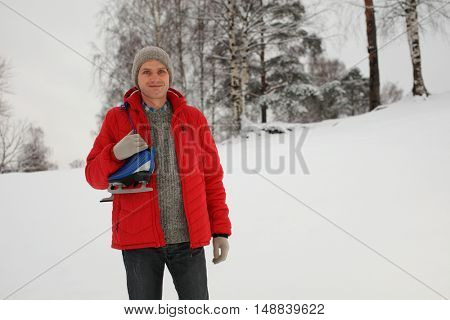 Mature man with skates outdoors