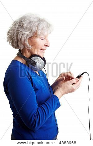 Senior Woman Using A Mp3 Player