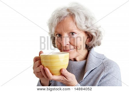 Old Woman With Cup Of Coffee