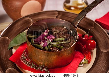 Hot dish with asparagus, meat and onion rings