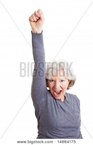 Cheering Senior Woman Clenching Her Fist