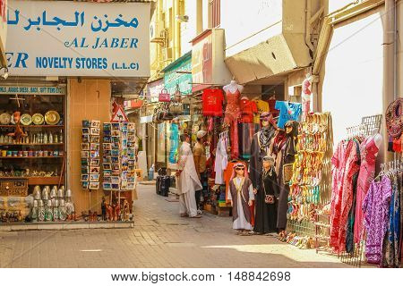 Dubai, United Arab Emirates - May 3, 2013: the traditional Grand Souk in Old Deira, historical Dubai. Arabs and tourists make shopping in traditional Souk.