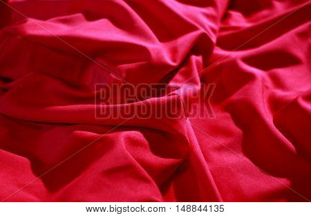 Red wrinkled silk sheets closeup stock image