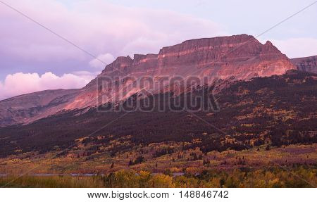 Fall color and sunrise comes to the mountains of East Glacier Montana