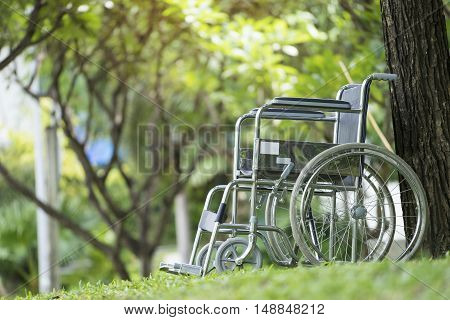 Empty wheelchair parked in park, healthy concept