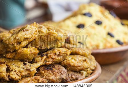 Vegetables fried rolls in batter also called Mshat Zahra and couscous. Moroccan recipes