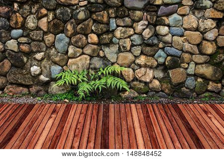 Wooden decking with stone wall garden decorative.