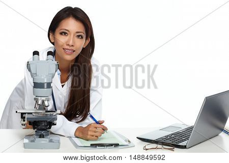 Chinese scientist woman with microscope.