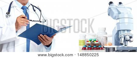 Doctor hands with microscope and pills.