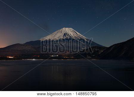 Mountain Fuji and Lake Motosu at night in winter