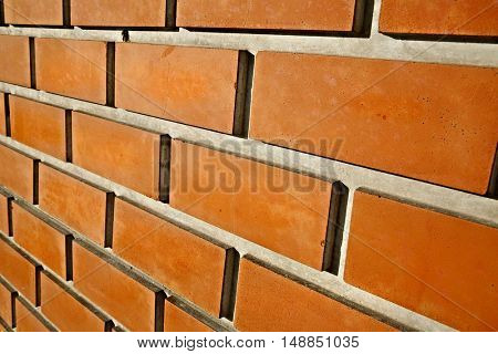 Bare brick wall angle closeup