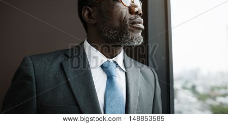 African Descent Businessman Contemplation Concept