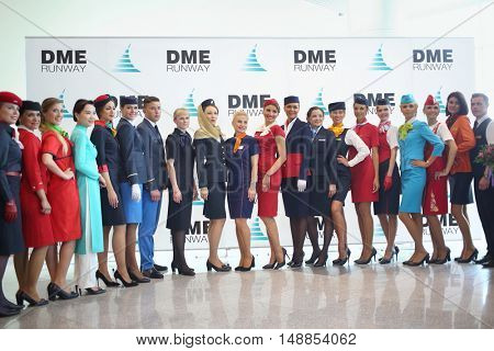 MOSCOW -?? JUL 09, 2015: Beautiful stewardess in uniform at a special screening of uniforms airlines DME RUNVAY in Domodedovo