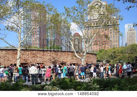 NEW YORK, USA - SEP 07, 2014: A crowd of people near the National Monument Castle Clinton in Battery Park