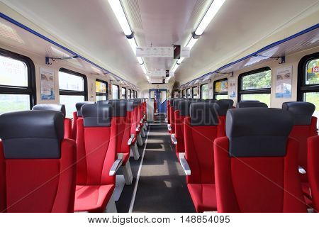 MOSCOW - JUL 09, 2015: Interior high-speed passenger train with empty red seats