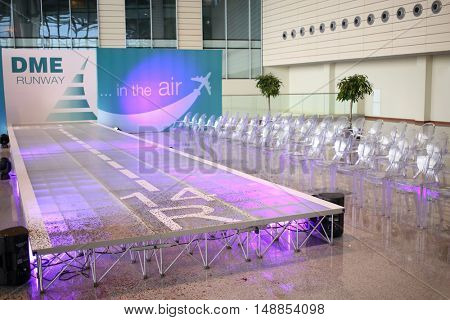 MOSCOW - JUL 09, 2015: The hall with a podium as a runway at a special screening of uniforms airlines DME RUNVAY in Domodedovo