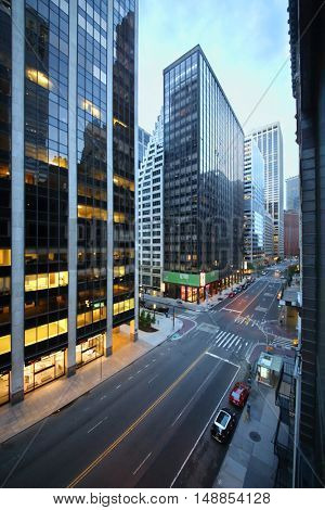 NEW YORK, USA - SEP 07, 2014: Crossroads of Wall Street and Water Street near office building in New York