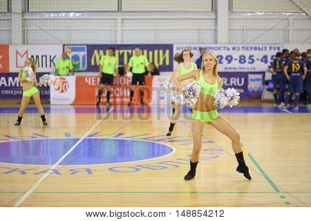 MYTISHCHI, RUSSIA - OCT 16, 2014: Girls cheerleader (with model release) dancing with shiny pompons in timeout in Russian Futsal Super League in Mytishchi