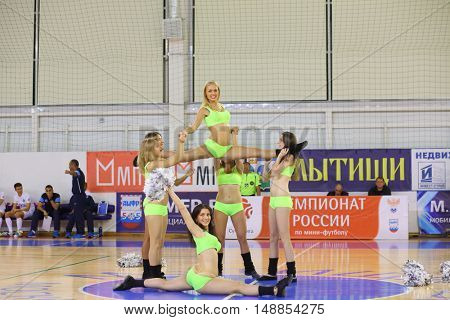 MYTISHCHI, RUSSIA - OCT 16, 2014: Six girls cheerleader (with model release) perform a dance support in timeout in Russian Futsal Super League in Mytishchi