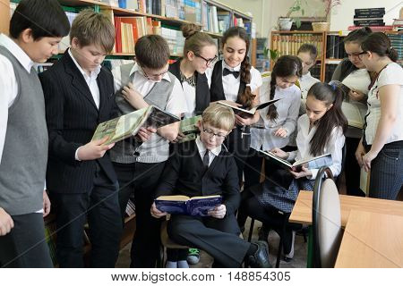 MOSCOW - MAR 20, 2015: Eleven students (with model releases) in school library. School 430 operating since 1981.