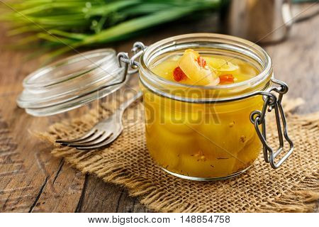 Pickled cucumber pieces with mustard seeds and dill