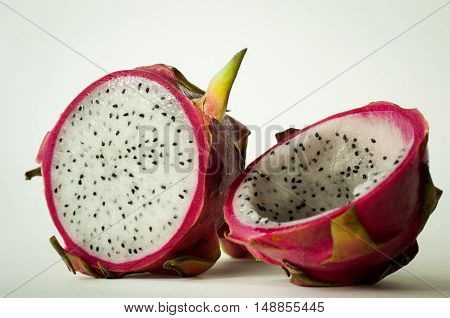 Fresh whole and half dragon fruit breakfast on whtie background isolated, dragon fruit or pitaya is the plant in Cactuceae family or Cactus