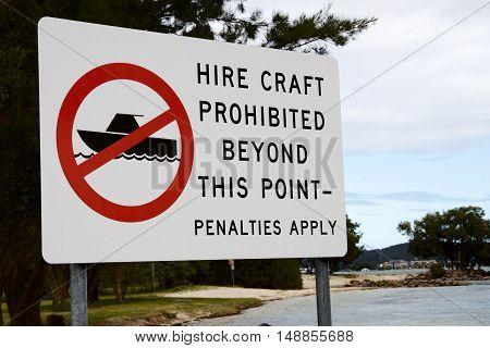 Hire craft prohibition signage at a lake.