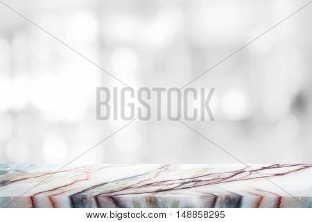 white marble stone countertop or table on white blurred abstract background / for display or montage your products