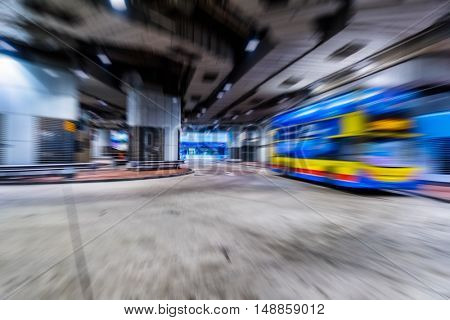 double-decker bus driving in a underground parking lot,hong kong,china.