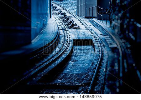 railroad tunnel with light at the corner,blue toned.
