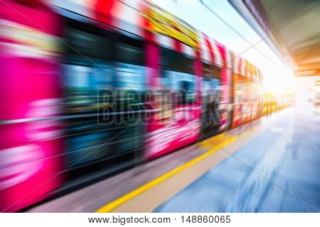 red speeding tram against sunbeam,hong kong,china.