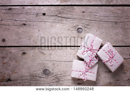 Wrapped christmas presents on aged wooden background. Selectife focus. Top view. Place for text.
