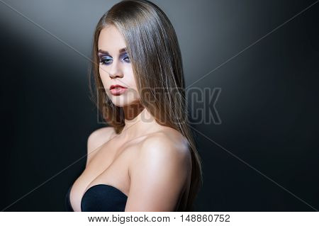 Beauty. Image of visage model posing with deep neckline